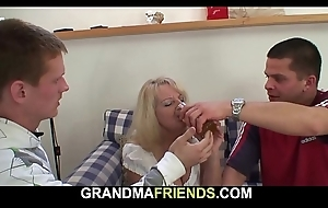 Crocked blonde grandmother takes two cocks